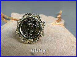14 KT SOLID GOLD 24 MM LADIES COIN RING with a 22 KT 1/10OZ LADY LIBERTY COIN
