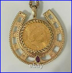 A 22CT gold 2001 full Sovereign Coin Pendant with Garnet on 9ct solid gold Chain