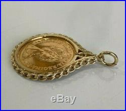 A 22k gold 1982 half Sovereign Coin in 9ct gold Pendant / Charm 6.37g