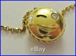 Genuine Roberto Coin Wink Emoji 18kt gold necklace withdiamond 18 inches