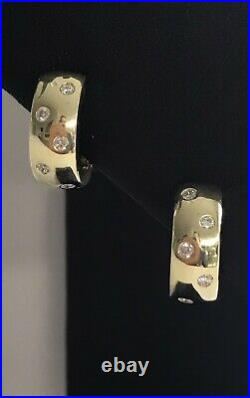 New Authentic Roberto Coin 18kt yellow gold huggy diamond 0.14 ct wrap earrings
